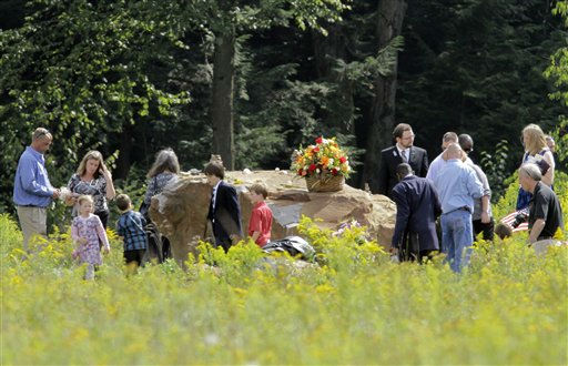 Family and friends gather at the boulder that marks the site of the crash of Flight 93 on Sept. 11, 2001, in Shanksville, Pa. Saturday Sept. 10, 2011 following the dedication of phase 1 of the permanent Flight 93 National Memorial.  &#40;AP Photo&#47;Gene J. Puskar&#41; <span class=meta>(AP Photo&#47; Gene J. Puskar)</span>