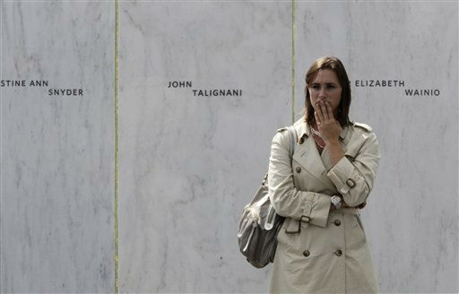 A mourner pauses as she stands at the Wall of Names after the dedication of the Flight 93 National Memorial  Sept. 10, 2011 in Shanksville, Pa. &#40;AP Photo&#47;Gene J. Puskar&#41; <span class=meta>(AP Photo&#47; Gene J. Puskar)</span>