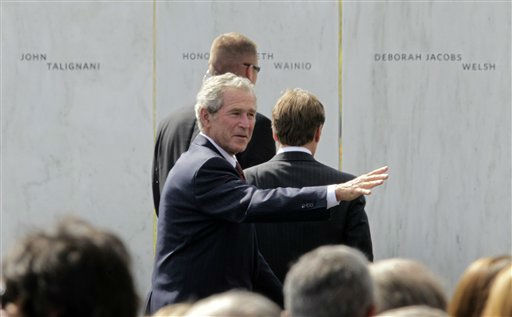 Former President George W. Bush waves to family and friends of the passengers and crew of Flight 93 as he walks past the Wall of Names after the dedication of the Flight 93 National Memorial  Sept. 10, 2011 in Shanksville, Pa. &#40;AP Photo&#47;Gene J. Puskar&#41; <span class=meta>(AP Photo&#47; Gene J. Puskar)</span>