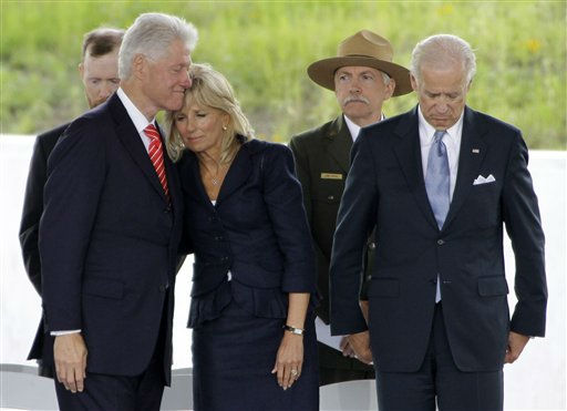 Former President Bill Clinton, left, hugs Dr. Jill Biden after remarks by Vice President Joe Biden, right, during the dedication of the Flight 93 National Memorial,  Sept. 10, 2011 in Shanksville, Pa.. Rear left, is Gordon Felt, whose brother Edward Felt was a passenger on Flight 93, and National Park Service Director Jon Jarvis. &#40;AP Photo&#47;Gene J. Puskar&#41; <span class=meta>(AP Photo&#47; Gene J. Puskar)</span>