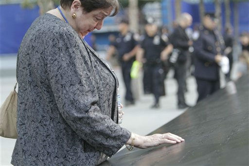 Maria Crifasi pays respects at the site where her sister Lucia Crifasi&#39;s name is engraved at the north pool at the National September 11 Memorial for a ceremony marking the 10th anniversary of the attacks at World Trade Center, Sunday, Sept. 11, 2011 in New York.  &#40;AP Photo&#47;Mary Altaffer&#41; <span class=meta>(AP Photo&#47; Mary Altaffer)</span>