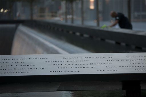 "<div class=""meta ""><span class=""caption-text "">A man looks at names that surround one of the reflecting pools before the 10th anniversary ceremony at the site of the World Trade Center, Sunday Sept. 11, 2011, in New York. (AP Photo/Todd Heisler, Pool) (AP Photo/ Todd Heisler)</span></div>"