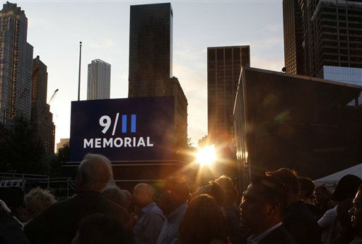 Friends and relatives of the victims of 9&#47;11 gather for a ceremony marking the 10th anniversary of the attacks at the National September 11 Memorial at the World Trade Center site, Sunday, Sept. 11, 2011, in New York. &#40;AP Photo&#47;Jason DeCrow&#41; <span class=meta>(AP Photo&#47; Jason DeCrow)</span>