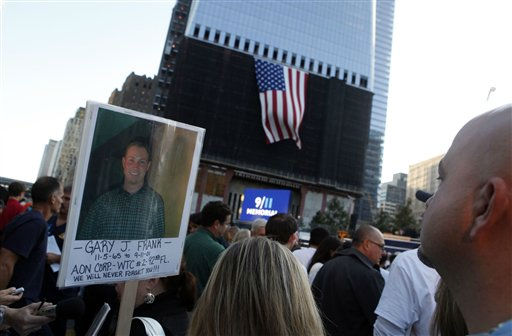 "<div class=""meta ""><span class=""caption-text "">A flag hangs from 1 World Trade Center as friends and relatives of the victims of 9/11 gather for a ceremony marking the 10th anniversary of the attacks at the National September 11 Memorial at the World Trade Center site, Sunday, Sept. 11, 2011, in New York. (AP Photo/Jason DeCrow) (AP Photo/ Jason DeCrow)</span></div>"