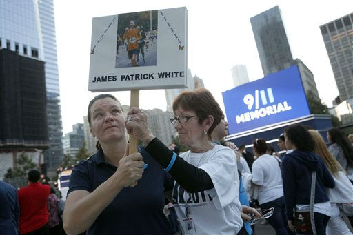 Rachel White, left, of Cherry Hill, N.J., and her aunt Dolores White, of Forest Hills, N.Y., hold aloft a sign memorializing Rachel&#39;s brother James Patrick White as friends and relatives of the victims of 9&#47;11 gather for a ceremony marking the 10th anniversary of the attacks at the National September 11 Memorial at the World Trade Center site, Sunday, Sept. 11, 2011, in New York. &#40;AP Photo&#47;Jason DeCrow&#41; <span class=meta>(AP Photo&#47; Jason DeCrow)</span>