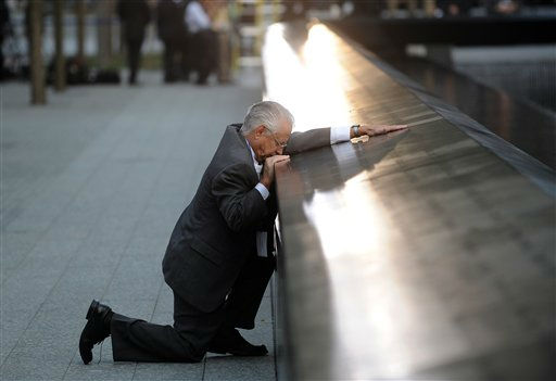 Robert Peraza, who lost his son Robert David Peraza in the attacks at the World Trade Center, pauses at his son&#39;s name at the North Pool of the 9&#47;11 Memorial before the 10th anniversary ceremony at the site, Sunday Sept. 11, 2011, in New York. &#40;AP Photo&#47;Justin Lane, Pool&#41; <span class=meta>(AP Photo&#47; Justin Lane)</span>