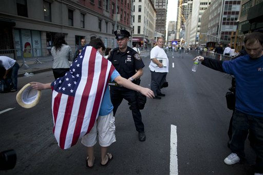 "<div class=""meta ""><span class=""caption-text "">Police officers perform security checks to the general public who arrive at the ceremony marking the 10th anniversary of the Sept. 11 terrorist attacks on the World Trade Center, outside ground zero in New York, Sunday, Sept. 11, 2011. (AP Photo/Oded Balilty) (AP Photo/ Oded Balilty)</span></div>"