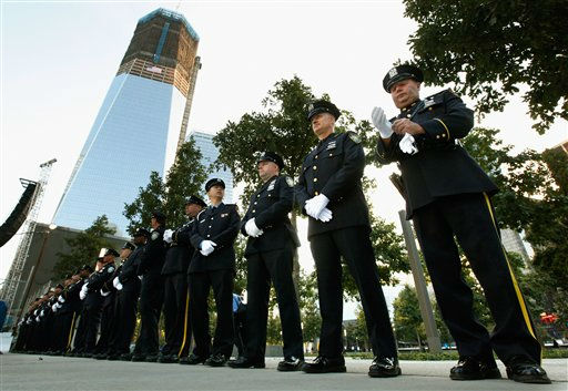 "<div class=""meta image-caption""><div class=""origin-logo origin-image ""><span></span></div><span class=""caption-text"">New York City police and firefighters, and Port Authority of NY and NJ police line up at one of the entrances of 9/11 Memorial Plaza before the 10th anniversary ceremony at the site of the World Trade Center, Sunday, Sept. 11, 2011, in New York. (AP Photo/Chip Somodevilla, Pool) (AP Photo/ Chip Somodevilla)</span></div>"