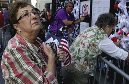 "<div class=""meta ""><span class=""caption-text "">Judy Busta of Protivin, Iowa, stands before ribbons of remembrance at St. Paul's Chapel near ground zero Sunday, Sept. 11, 2011 as she came to New York to commemorate the 10th anniversary of the attacks at the World Trade Center. (AP Photo/Craig Ruttle) (AP Photo/ Craig Ruttle)</span></div>"