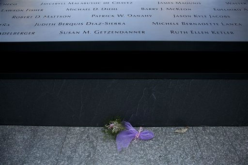 Flowers lay at the base of the south reflecting pool before tenth anniversary ceremonies of the terrorist attacks at the site of the World Trade Center, Sunday, Sept. 11, 2011, in New York. &#40;AP Photo&#47;Todd Heisler, Pool&#41; <span class=meta>(AP Photo&#47; TODD HEISLER)</span>