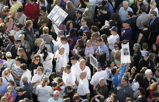 "<div class=""meta image-caption""><div class=""origin-logo origin-image ""><span></span></div><span class=""caption-text"">Family members hold photos of victims before the ceremony marking the 10th anniversary of the attacks, at the September 11 Memorial site at the World Trade Center in New York Sunday, Sept. 11, 2011. (AP Photo/Mark Lennihan) (AP Photo/ Mark Lennihan)</span></div>"