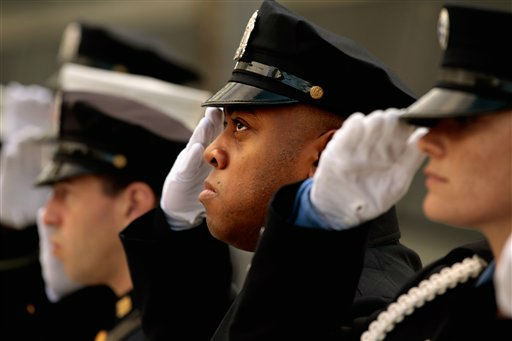 "<div class=""meta ""><span class=""caption-text "">New York City police and firefighters, and Port Authority of NY & NJ police officers salute during the singing of the ""Star Spangled Banner"" at the Sept. 11 memorial, during 10th anniversary ceremonies at the site, Sunday, Sept. 11, 2011, in New York. (AP Photo/Chip Somodevilla, Pool) (AP Photo/ Chip Somodevilla)</span></div>"