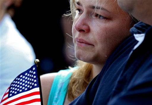 Jacqueline Arana, of Union City, N.J., sheds a tear at 8:46 a.m., marking when the first plane hit the World Trade Center in 2001, during a ceremony in Lower Manhattan, Sunday, Sept. 11, 2011, marking the 10th anniversary of the attacks at the World Trade Center. &#40;AP Photo&#47;Craig Ruttle&#41; <span class=meta>(AP Photo&#47; Craig Ruttle)</span>