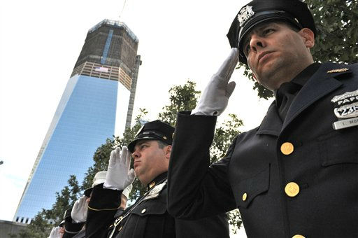 "<div class=""meta ""><span class=""caption-text "">Members of the New York City police and fire departments join police officers from the Port Authority of New York and New Jersey while the Star Spangled Banner is played at the 10th anniversary commemoration of the of the terrorist attacks on the World Trade Center, Sunday, Sept. 11, 2011 in New York. (AP Photo/Aaron Showalter, Pool) (AP Photo/ AARON SHOWALTER)</span></div>"