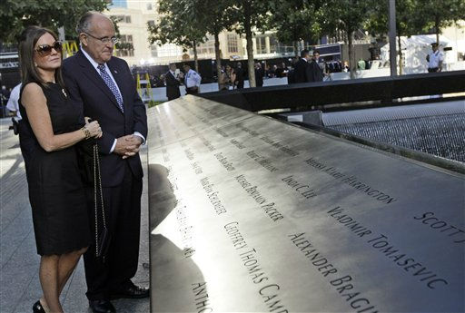Former New York City Mayor Rudy Giuliani and his wife Judith Nathan pay their respects at the north reflection pool near the bronze-etched names of the victims of the 9&#47;11 terrorist attack on the National September 11 Memorial during a ceremony marking the 10th anniversary of the attacks at World Trade Center, Sunday, Sept. 11, 2011 in New York.  &#40;AP Photo&#47;Mary Altaffer&#41; <span class=meta>(AP Photo&#47; Mary Altaffer)</span>