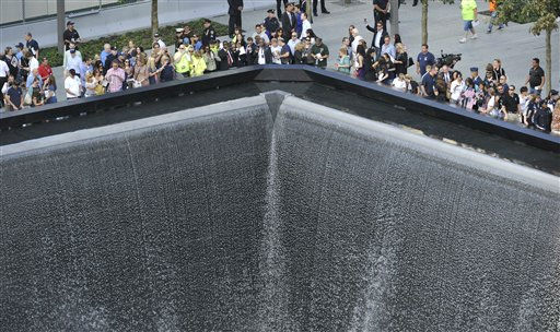 "<div class=""meta ""><span class=""caption-text "">Families gather around the south memorial pool at the Sept. 11 memorial during 10th anniversary ceremonies of the terrorist attacks, Sunday, Sept. 11, 2011, at the World Trade Center, in New York. (AP Photo/Robert Deutsch, Pool) (AP Photo/ ROBERT DEUTSCH)</span></div>"