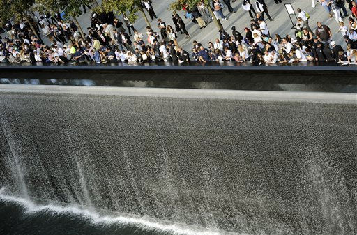 Families line up against the wall of the south memorial pool at the Sept. 11 memorial during 10th anniversary ceremonies commemorating the 2001 terrorist attacks on the World Trade Center, Sunday, Sept. 11, 2011, in New York. &#40;AP Photo, Timothy A. Clary, Pool&#41; <span class=meta>(AP Photo&#47; TIMOTHY A.  CLARY)</span>