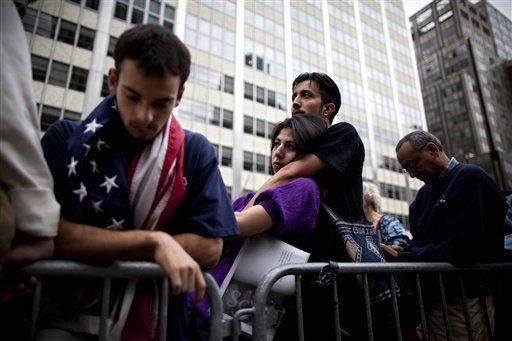 People gather during a ceremony marking the 10th anniversary of the attacks on the World Trade Center Sunday, Sept. 11, 2011, outside the World Trade Center site in New York. &#40;AP Photo&#47;Oded Balilty&#41; <span class=meta>(AP Photo&#47; Oded Balilty)</span>