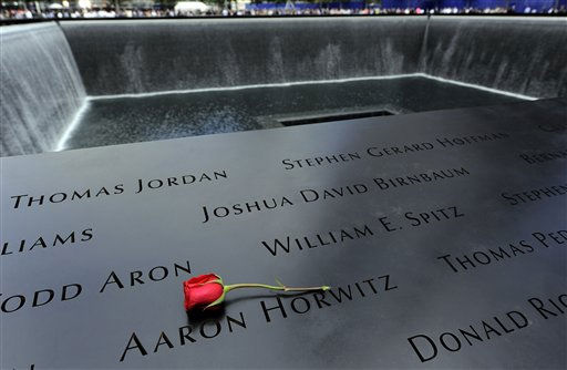 "<div class=""meta image-caption""><div class=""origin-logo origin-image ""><span></span></div><span class=""caption-text"">A single rose lies above one of the names inscribed on a wall at the Sept. 11 memorial in New York, Sunday, Sept. 11, 2011, as families who lost loved ones in the World Trade Center attacks joined others to make the 10th anniversary of those attacks. (AP Photo/Justin Lane, Pool) (AP Photo/ JUSTIN LANE)</span></div>"