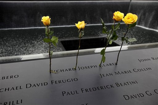 "<div class=""meta image-caption""><div class=""origin-logo origin-image ""><span></span></div><span class=""caption-text"">Roses are placed in the name of a person killed during the Sept. 11 World Trade Center attacks, etched in the area surrounding a reflecting pool of the Sept. 11 memorial, during 10th anniversary commemoration ceremonies at the site, in New York, Sunday, Sept. 11, 2011. (AP Photo/Seth Wenig, Pool) (AP Photo/ Seth Wenig)</span></div>"