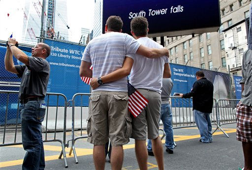Ryan Wilson, left, of Anaheim, Calif., and Tim Berndtson, of Long Beach, Calif., stand at 9:59 a.m. Sunday, Sept. 11, 2011, marking the fall of the south tower, during a ceremony marking the 10th anniversary of the attacks at the World Trade Center, in New York. &#40;AP Photo&#47;Craig Ruttle&#41; <span class=meta>(AP Photo&#47; Craig Ruttle)</span>