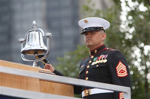 "<div class=""meta image-caption""><div class=""origin-logo origin-image ""><span></span></div><span class=""caption-text"">A U.S. Marine Gunnery Sargent rings a bell making the collapse of one of the towers, Sunday, Sept. 11, 2011 in New York, during the 10th anniversary observance of the terrorist attacks on the World Trade Center. (AP Photo/Allan Tannenbaum, Pool) (AP Photo/ Allan Tannenbaum)</span></div>"