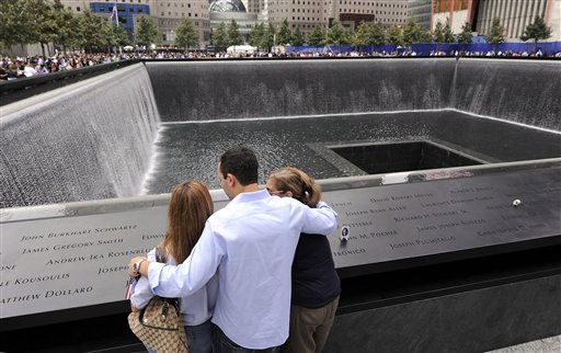 Family members of those who died in the Sept. 11, 2001 World Trade Center attacks, gather at the edge of the north reflecting pool of the Sept. 11 memorial during 10th anniversary ceremonies at the site, in New York, Sunday Sept. 11, 2011. &#40;AP Photo&#47;Justin Lane, Pool&#41; <span class=meta>(AP Photo&#47; Justin Lane)</span>