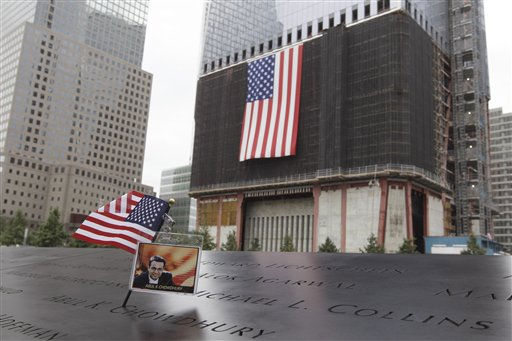 "<div class=""meta image-caption""><div class=""origin-logo origin-image ""><span></span></div><span class=""caption-text"">An American flag and a photo of Abul K. Chowdhury are on his name, engraved at the north pool of the National September 11 Memorial during a ceremony marking the 10th anniversary of the attacks at the World Trade Center, Sunday, Sept. 11, 2011 in New York.  (AP Photo/Mary Altaffer) (AP Photo/ Mary Altaffer)</span></div>"