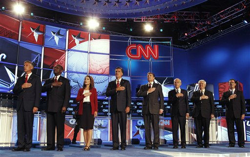 "<div class=""meta ""><span class=""caption-text "">Republican presidential candidates, from left, Utah Gov. Jon Huntsman, businessman Herman Cain, Rep. Michele Bachmann, R-Minn., former Massachusetts Gov. Mitt Romney, Texas Gov. Rick Perry, Rep. Ron Paul, R-Texas, former House Speaker Newt Gingrich, and former Pennsylvania Sen. Rick Santorum, sing the National Anthem before a Republican presidential debate Monday, Sept. 12, 2011, in Tampa, Fla. (AP Photo/Chris O'Meara) (AP Photo/ Chris O'Meara)</span></div>"