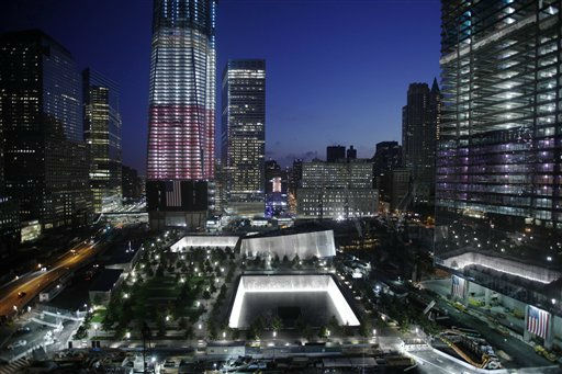 "<div class=""meta ""><span class=""caption-text "">One World Trade Center and the National September 11 Memorial are seen, Monday, Sept. 12, 2011, in New York. The memorial is scheduled to the public Monday, with much of the complex expected to open next year. (AP Photo/Matt Rourke) (AP Photo/ Matt Rourke)</span></div>"
