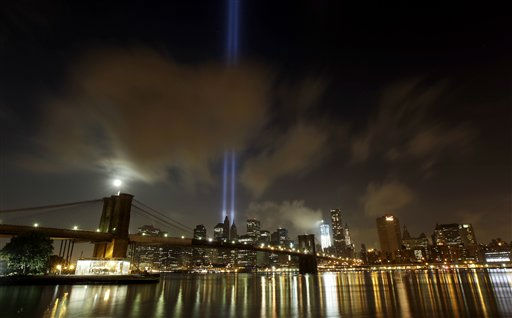 The Tribute in Light rises over the Brooklyn Bridge and lower Manhattan, Monday, Sept. 12, 2011, in New York. A day earlier the city held a memorial at Ground Zero for the 10th anniversary of the attacks on the United States. &#40;AP Photo&#47;Julio Cortez&#41; <span class=meta>(AP Photo&#47; Julio Cortez)</span>
