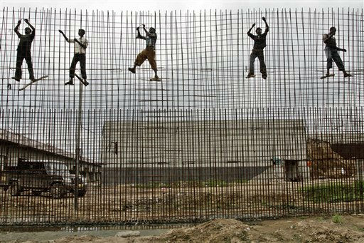 Indian laborers work at Sabarmati Riverfront Development Project site in Ahmadabad, India, Monday, Sep. 12, 2011. &#40;AP Photo&#47;Ajit Solanki&#41; <span class=meta>(AP Photo&#47; Ajit Solanki)</span>