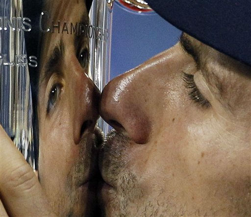 Novak Djokovic, of Serbia, kisses the trophy after winning the men&#39;s championship match against Rafael Nadal, of Spain, at the U.S. Open tennis tournament in New York, Monday, Sept. 12, 2011. &#40;AP Photo&#47;Charles Krupa&#41; <span class=meta>(AP Photo&#47; Charles Krupa)</span>