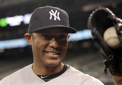 "<div class=""meta image-caption""><div class=""origin-logo origin-image ""><span></span></div><span class=""caption-text"">New York Yankees closer Mariano Rivera clutches a baseball in his glove as he leaves the field after the team beat the Seattle Mariners in a baseball game Tuesday, Sept. 13, 2011, in Seattle. The Yankees won 3-2. It was Rivera's 600th save. (AP Photo/Elaine Thompson) (AP Photo/ Elaine Thompson)</span></div>"