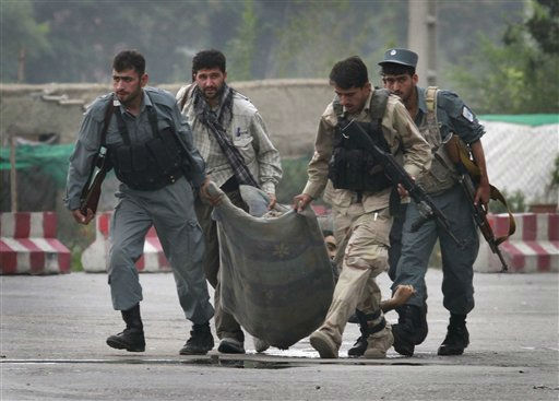 "<div class=""meta ""><span class=""caption-text "">Afghan security forces carry the body of a colleague, who was killed during a gun battle with Taliban militants in Kabul, Afghanistan on Wednesday Sept. 14,2011.  The 20-hour insurgent attack in the heart of Kabul ended Wednesday morning after a final volley of helicopter gunfire as Afghan police ferreted out and killed the last few assailants who had taken over a half-built downtown building to fire on the nearby U.S. Embassy and NATO compounds.  (AP Photo/Musadeq Sadeq) (AP Photo/ Musadeq Sadeq)</span></div>"