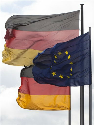 A European and two German national flags fly in the wind at the Place of the Republic in Berlin&#39;s government district, Thursday, Sept. 15, 2011. German Chancellor Angela Merkel said Thursday it is &#34;completely clear&#34; that Germany, the continent&#39;s biggest economy, has a &#34;duty and responsibility to make its contribution to securing the euro&#39;s future.&#34; &#40;Photo&#47;Markus Schreiber&#41; <span class=meta>(AP Photo&#47; Markus Schreiber)</span>