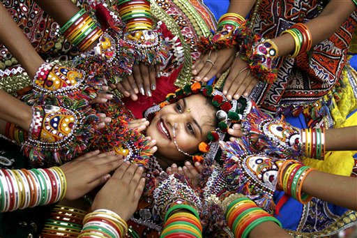 An Indian girl, wearing traditional attire, poses for photographers as she along with others perform the Garba, a traditional dance of western Indian state of Gujarat, as part of preparation for Navratri festival in Ahmadabad, India, Thursday, Sept. 15, 2011. Navratri, or festival of nine nights, begins Sept. 28. &#40;AP Photo&#47;Ajit Solanki&#41; <span class=meta>(AP Photo&#47; Ajit Solanki)</span>