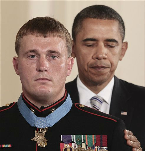 President Barack Obama awards the Medal of Honor to former Marine Corps Cpl. Dakota Meyer, 23, from Greensburg, Ky., Thursday, Sept. 15, 2011, during a ceremony in the East Room of the White House in Washington. Meyer was in Afghanistan&#39;s Kunar province in Sept. 2009 when he repeatedly ran through enemy fire to recover the bodies of fellow American troops. He is the first living Marine to be awarded the Medal of Honor for actions in Iraq or Afghanistan. &#40;AP Photo&#47;Pablo Martinez Monsivais&#41; <span class=meta>(Photo&#47;Pablo Martinez Monsivais)</span>