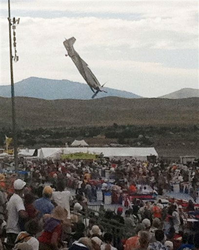 "<div class=""meta ""><span class=""caption-text "">In this Friday, Sept. 16, 2011 photo, a P-51 Mustang airplane approaches the ground right before crashing during an air show in Reno, Nev. The vintage World War II-era fighter plane piloted by Jimmy Leeward plunged into the grandstands during the popular annual air show. (AP Photo/Garret Woodman) (AP Photo/ Garret Woodman)</span></div>"