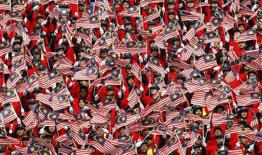 Malaysian students wave their national flags during Malaysia Day celebrations at Independence Square in Kuala Lumpur, Malaysia, Friday, Sept. 16, 2011. The country celebrates the holiday on Sept. 16 to commemorate the formation of the Malaysia federation which was announced on the same date in 1963. &#40;AP Photo&#47;Lai Seng Sin&#41; <span class=meta>(AP Photo&#47; Lai Seng Sin)</span>