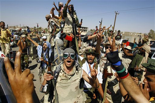 Libyan fighters chants slogans as they take control of Moammar Gadhafi loyalists&#39; villages in the desert some 750 km south of Tripoli, at Gohta, north of the southern city of Sebbah, Libya, Sunday, Sept. 18, 2011. &#40;AP Photo&#47;Francois Mori&#41; <span class=meta>(AP Photo&#47; Francois Mori)</span>