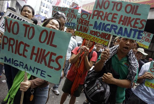 "<div class=""meta ""><span class=""caption-text "">Protesters shout slogans during a rally in suburban Quezon city, north of Manila, Philippines, Monday, Sept. 19, 2011 as part of a nationwide ""transport holiday"" after continued oil price hikes in the past weeks. Protest leaders said Sunday that they want the government to scrap an oil deregulation law and a consumption tax that have helped oil prices soar to record highs. (AP Photo/Aaron Favila) (AP Photo/ Aaron Favila)</span></div>"