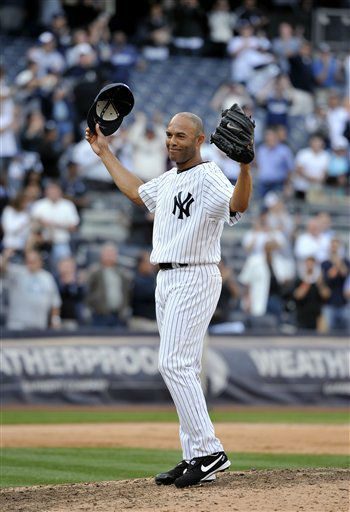 New York Yankees closer Mariano Rivera acknowledges the cheers of the crowd after recording his 602nd career, after the Yankees beat the Minnesota Twins 6-4 in a baseball game Monday, Sept. 19, 2011, at Yankee Stadium in New York. Rivera pitched a perfect ninth as he broke the record held by Trevor Hoffman. &#40;AP Photo&#47;Kathy Kmonicek&#41; <span class=meta>(AP Photo&#47; Kathy Kmonicek)</span>