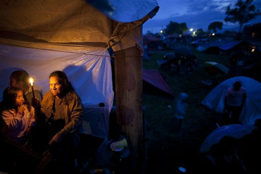 "<div class=""meta image-caption""><div class=""origin-logo origin-image ""><span></span></div><span class=""caption-text"">People take refugee at a makeshift shelter after earthquakes in Cuilapa, Guatemala, Monday, Sept. 19,  2011. Four earthquakes struck the southeastern part of Guatemala in less than two hours Monday afternoon, causing at least one death, authorities said. At least three people were reported missing. (AP Photo/Rodrigo Abd) (AP Photo/ Rodrigo Abd)</span></div>"