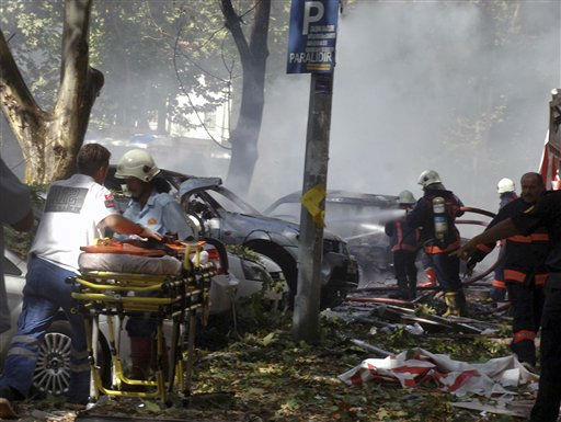 "<div class=""meta ""><span class=""caption-text "">An ambulance worker with a stretcher arrives as firefighters and security officials work at the site of a suspected car bomb explosion in a busy street in the Turkish capital Ankara, Turkey, Tuesday, Sept. 20, 2011. A car bomb went off near a high school in the Turkish capital on Tuesday, igniting other vehicles and killing three people in a nearby building, authorities said. The blast also wounded 15 people. (AP Photo) (AP Photo/ Anonymous)</span></div>"