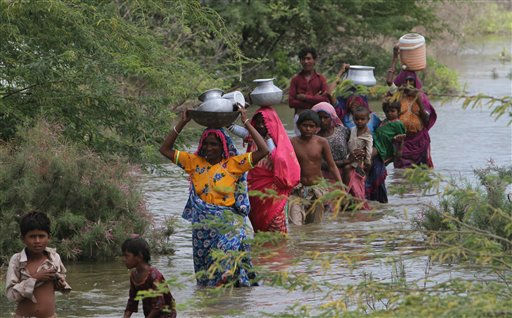 Displaced Pakistani villagers walk in search of clean water after fleeing their homes in Badin district near Hyderabad, Pakistan, on Wednesday, Sept 21, 2011.  The U.N. issued an appeal Sunday for &#36;357 million to provide food, water, sanitation, health and emergency shelter to flood victims, but admit that fulfilling the appeal could prove difficult. &#40;AP Photo&#47;Fareed Khan&#41; <span class=meta>(AP Photo&#47; Fareed Khan)</span>