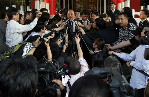 "<div class=""meta ""><span class=""caption-text "">North Korea's nuclear envoy Ri Yong Ho, center top,  talks to journalists outside the private Chang An Club after talks with South Korea's nuclear envoy Wi Sung-lac in Beijing, China, Wednesday, Sept. 21, 2011. The representatives of North and South Korea met Wednesday for crucial talks, renewing optimism that Pyongyang could be persuaded to resume discussions on ending its nuclear program after it walked out two years ago.  (AP Photo/Ng Han Guan) (AP Photo/ Ng Han Guan)</span></div>"