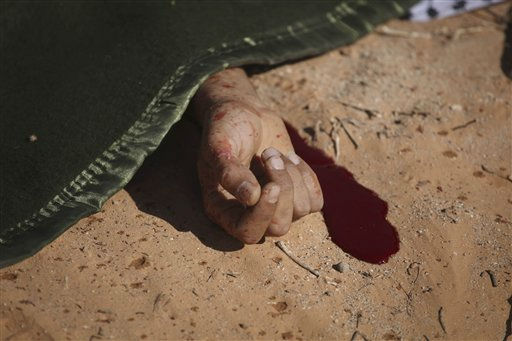 "<div class=""meta ""><span class=""caption-text "">A former rebel fighter lays shrouded after a rocket propelled grenade accident in Wadi Dinar, Libya, Wednesday, Sept. 21, 2011.  A commander of new government's forces said late Tuesday they were in control of most of the Gadhafi desert stronghold of Sabha after a day of fighting. The commander, Bashir Ahwaz, said most of the tribesmen loyal to Gadhafi fled the city instead of putting up a fight. (AP Photo/Alexandre Meneghini) (AP Photo/ Alexandre Meneghini)</span></div>"