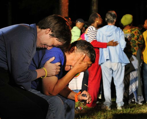 Minister Lynn Hopkins, left, comforts her partner Carolyn Bond after hearing that the U.S. Supreme Court rejected a last minute plea of  Georgia death row inmate Troy Davis In Jackson, Ga., Wednesday, Sept. 21, 2011. Davis was scheduled to be executed on Wednesday for killing off-duty Savannah officer Mark MacPhail. &#40;AP&#47;Photo Stephen Morton&#41; <span class=meta>(AP Photo&#47; Stephen Morton)</span>
