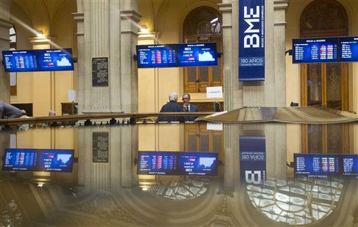 "<div class=""meta ""><span class=""caption-text "">Two brokers talk as screens are reflected from a glass table at the Stock Exchange in Madrid Thursday Sept. 22, 2011. World stocks skidded lower Thursday, stung by the Federal Reserve's pessimistic assessment of the U.S. economy and the perceived ineffectiveness of measures to kickstart growth.  On top of that: a sovereign-debt crisis in Europe that is threatening to bankrupt Greece, cause Italy to default on debts and infect the continent's banking system. (AP Photo/Paul White) (AP Photo/ Paul White)</span></div>"